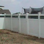 Privacy Fence with Green Lattice